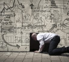 Businessman crawling into a small black hole, with illustrations on the wall
