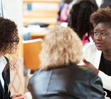 Women having discussions at Cambridge Judge Business School