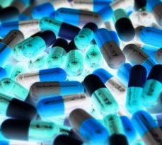 Pile of blue, green and white pills.