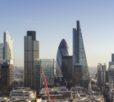 Elevated view of The City of London, early morning. The capital's global business and finance district employs hundreds of thousands of people. The City's skyline is constantly evolving, to the right of the distinctive 'Gherkin', Tower 42 and Heron Tower skyscrapers is the new 'Cheesegrater' skyscraper.