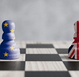 Two pawns with UK and European flags on a chess board