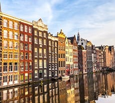Sunset in Amsterdam. Typical Dutch Houses in the Center of Amsterdam